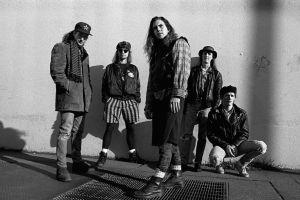 shadow 90's monochrome street doc martens rock bands seattle grunge long hair musician men rock stars wall