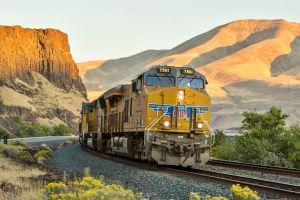 shadow diesel locomotive hills cliff railway vehicle desert train