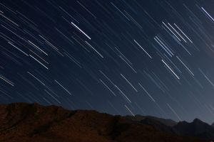 shooting stars night landscape mountains