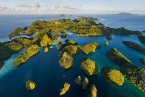 shrubs sunset green indonesia beach landscape rock blue hills nature sea water island tropical limestone