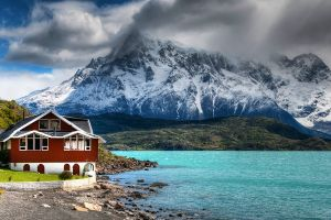 shrubs water chile house clouds lake grass mountains turquoise nature snowy peak landscape