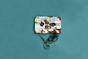simple background rust destruction tape cassette blue background minimalism vintage digital art text