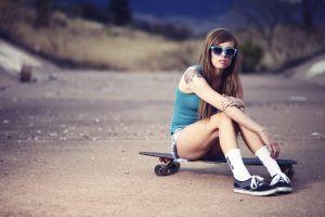 sitting longboard blue tops trees sneakers tattoo depth of field model long hair skateboard nature tank top brunette women jeans