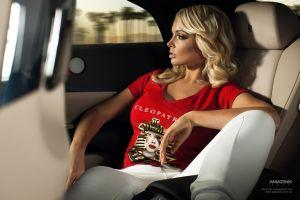sitting looking away car women blonde