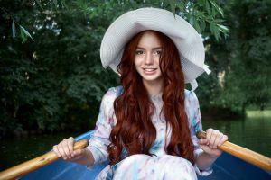 sitting river boat smiling redhead women model