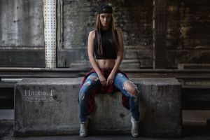 sitting torn jeans women jeans