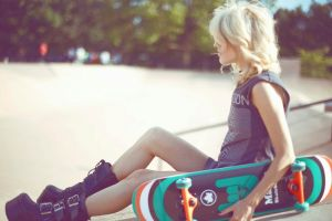 skateboard blonde women looking away boots