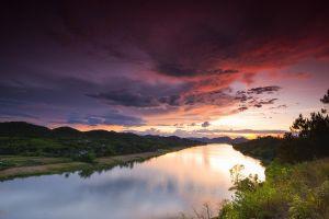 sky field river clouds nature sunset plants landscape