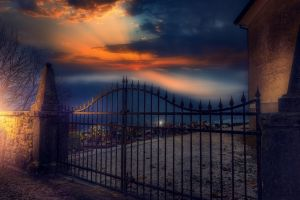sky gates nature sun rays cemetery closed sunset grave lights landscape
