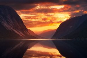 sky landscape norway fjord midnight sea nature sunset sun rays mountains calm clouds