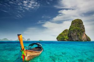 sky nature rock trees boat clouds water landscape sea island halong bay railay beach