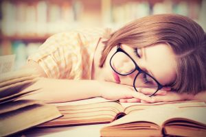 sleeping closed eyes introvert nerds women hands shelves shirt books brunette checkered long hair face model women with glasses