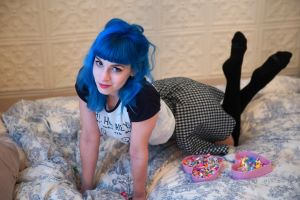smiling dyed hair women blue model blue hair kneeling feet in the air black stockings heart in bed suicide girls