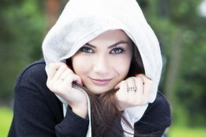 smiling hoods portrait women brunette green eyes