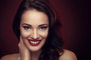 smiling long hair red lipstick face closeup redhead women