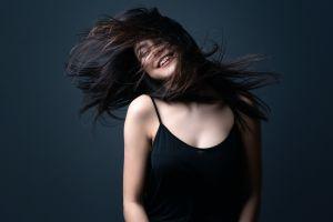 smiling long hair tank top women hair in face model brunette black tops