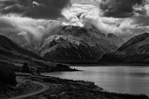 snowy peak clouds dark trees mountains monochrome scotland nature road landscape lake