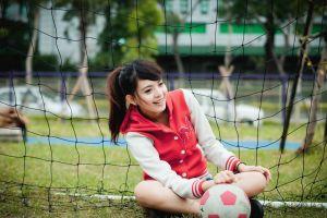 soccer ball grass asian women outdoors trees sitting ponytail nets brunette holding knees model women sports smiling long hair