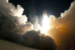 space shuttle launching nasa smoke