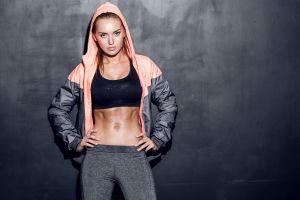 sports bra blonde looking at viewer sweat body fitness model skinny abs hands on hips leggings women hoods blue eyes sporty simple background