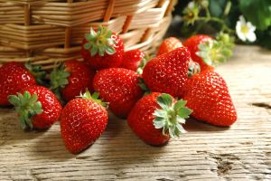 strawberries wooden surface food fruit