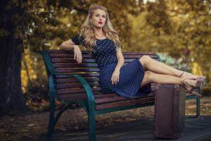 suitcase long hair sitting model blue dress bench polka dots blonde high heels depth of field leaning dress looking at viewer women outdoors women