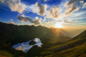 sun rays mountains water lake clouds sunset reflection sky mist landscape nature