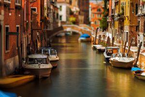 sunlight depth of field canal daylight venice urban boat