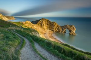 sunlight field horizon cliff clouds sea long exposure grass calm nature coast beach sand landscape durdle door