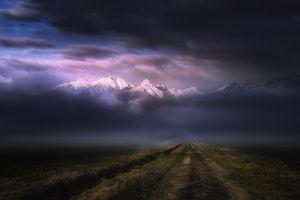 sunlight nature mountains dirt road landscape clouds dark mist sunset snowy peak