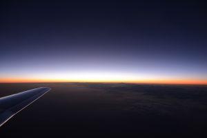 sunrise airplane wing landscape horizon sky