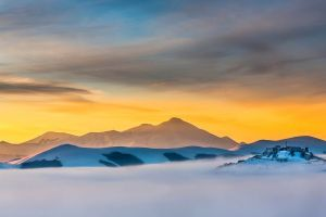 sunset mist snow house clouds trees old building morning village italy winter landscape nature hills mountains