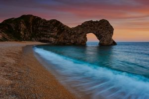 sunset rock formation sea beach jurassic coast durdle door landscape coast