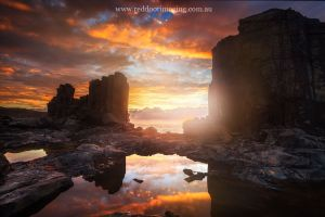 sunset rock formation sea landscape australia