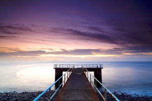 sunset sea pier nature landscape calm beach