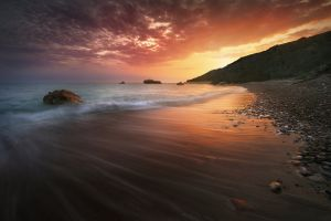 sunset water long exposure stones cyprus clouds stone beach nature sea