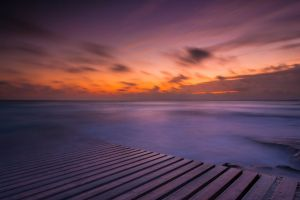 sunset wooden surface waves pier horizon planks clouds nature sea landscape long exposure rock water
