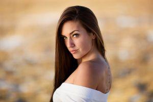 tattoo bare shoulders depth of field women portrait sensual gaze nose rings long hair model