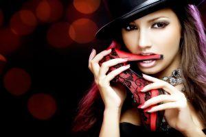 teeth hat hands lights women necklace model face high heels brunette biting stiletto