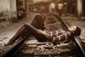 tights long hair knee-high boots women outdoors brunette railway urban depth of field lying on back street stones women model shirt people