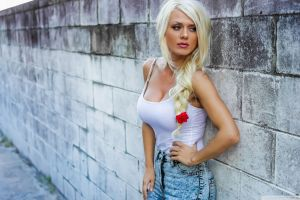 torn jeans aida ridic long hair white shirt braids cleavage women tanned platinum blonde flower in hair blonde rose