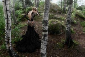 trees hairbun blonde long skirt women outdoors black dress women hands on hips backless back