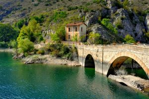 trees water italy rock old building house architecture arch bridge