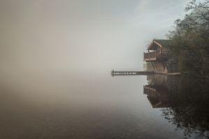 trees water mist boathouses morning reflection lake landscape calm england nature