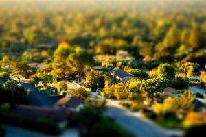 village aerial view tilt shift urban trees