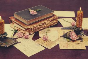 vintage paper table rose old books candles