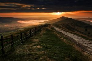 walkway sky mountains mist shrubs path grass fence clouds nature