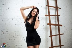wall women hands in hair black dress