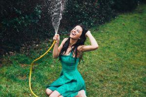 water drops kneeling dress women green dress black hair aurela skandaj