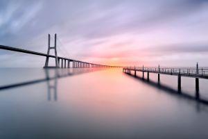 water shadow calm vasco da gama bridge portugal long exposure bridge clouds lisbon sunset photography pier landscape sea sunrise